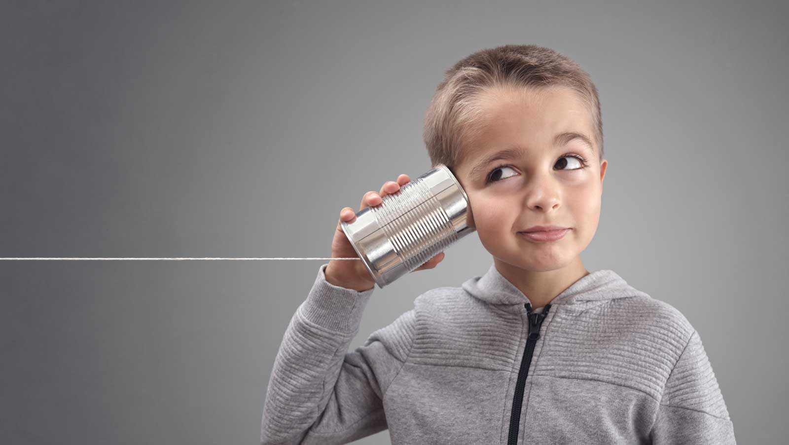 Boy listening to can for news